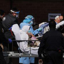 JAV užregistruotos 1 297 naujos mirtys nuo COVID-19