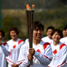 Tokijo olimpiados deglas pradeda 121 dieną truksiančią kelionę per Japoniją