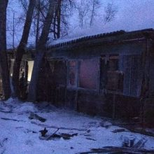 Rusijoje užsiliepsnojus mediniam namui žuvo 11 žmonių