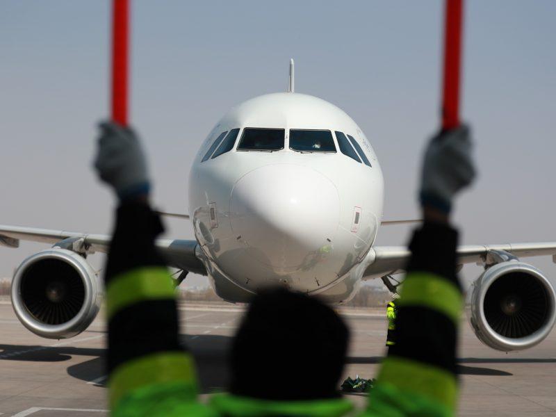 Kinija drastiškai mažina tarptautinių skrydžių skaičių
